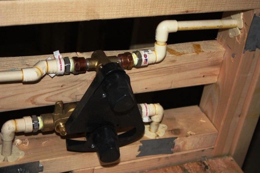 The roughed-in plumbing includes the shower controls in both bathrooms.