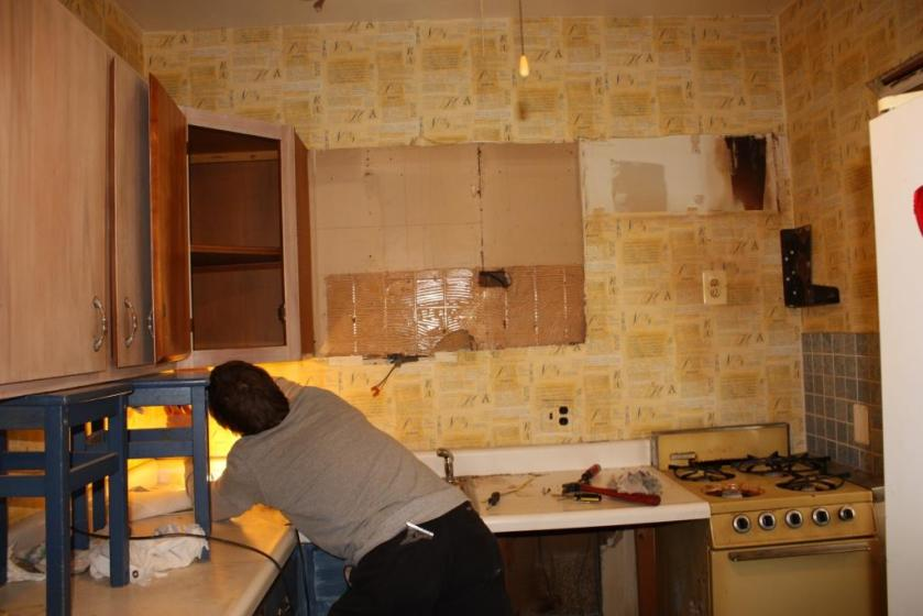 Removing the cabinets from the old kitchen.