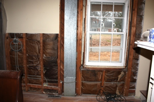The window has ductwork running down the left side which cannot b e moved.
