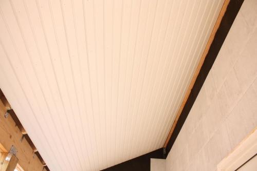 The side porch ceiling primed in white.