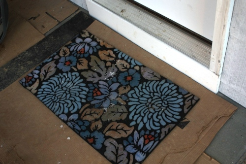 The door mats are predominantly blue with touches of orange and ochre.