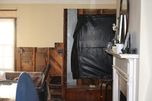 The window was removed and placed in the opening (at left) created by removing the front door.
