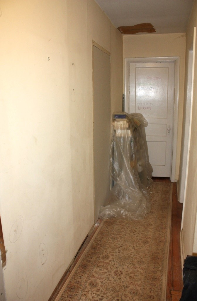 The doorway was drywalled back in December but the hall still needs to be painted.