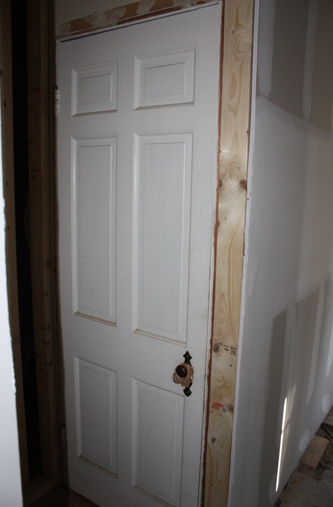 Six-panel door basement door.