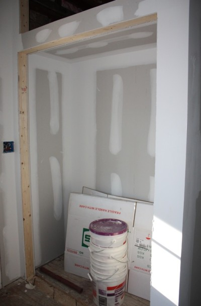 This closet in the mudroom will get double doors below and some doors covering the niche above.