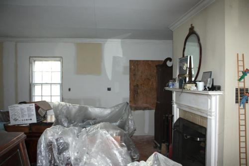 The front wall with the window inserted in the former doorway and sheetrock applied to the wall.