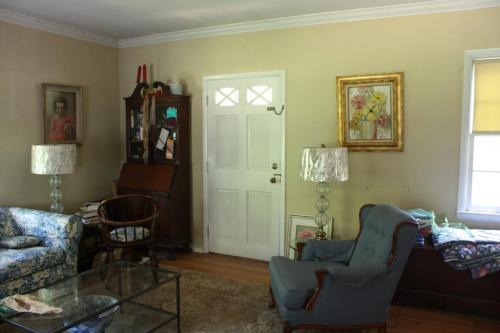 The living room door has exchanged places with the window on the right in the picture above.
