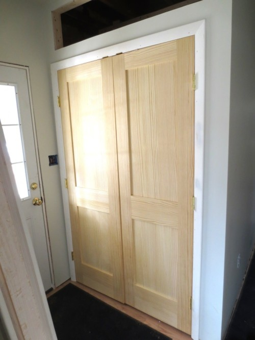 The mudroom closet doors are bare wood which Charlie adores. Me, not so much.