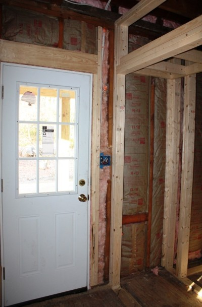The mudroom closet is to the right of the door in the photo above.