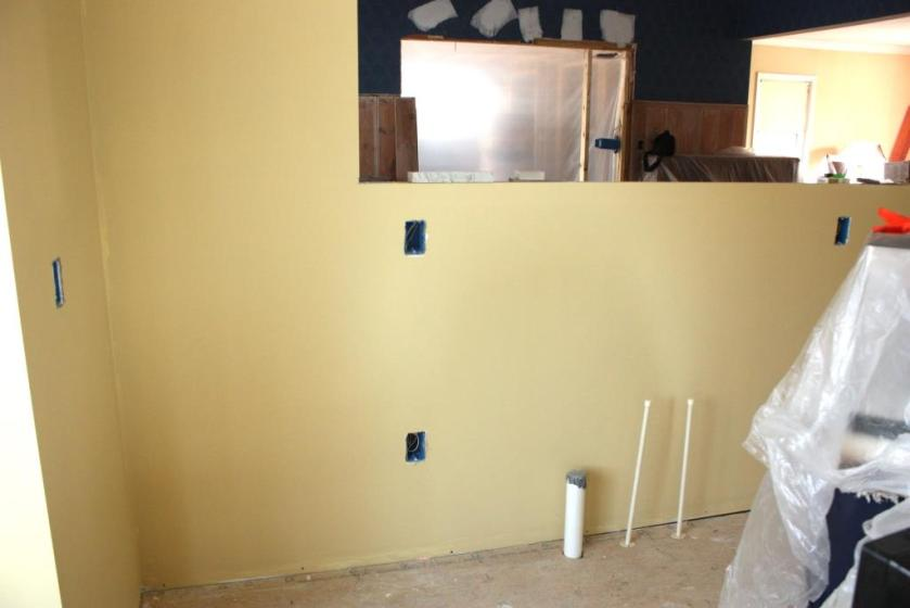 The knee wall from the kitchen side of the peninsula has been turned into our caffe bar.