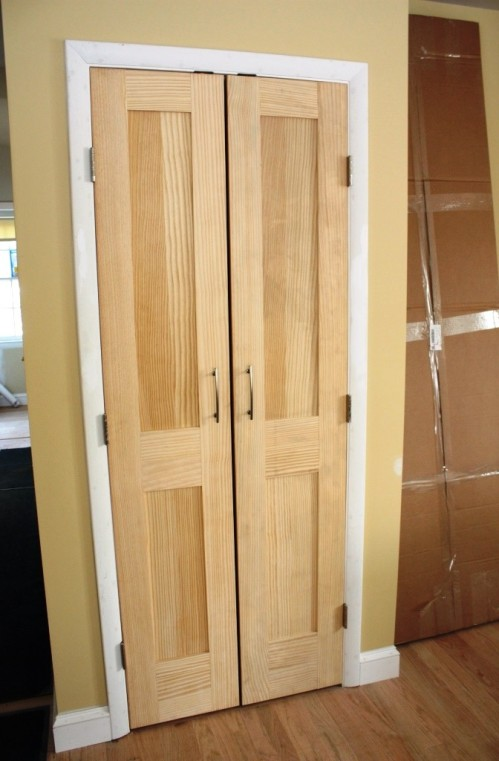 The master closet will get Shaker-style double doors  like those on the pantry.