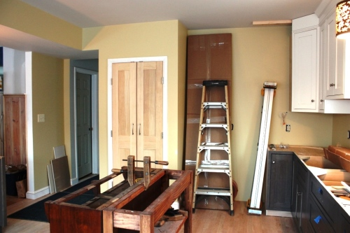 We're waiting for cabinets to finish the upper and lower runs before we install the refrigerator next to the pantry (