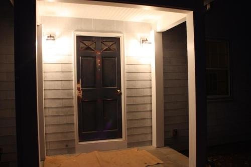 The front door lights fully illuminate the front porch.