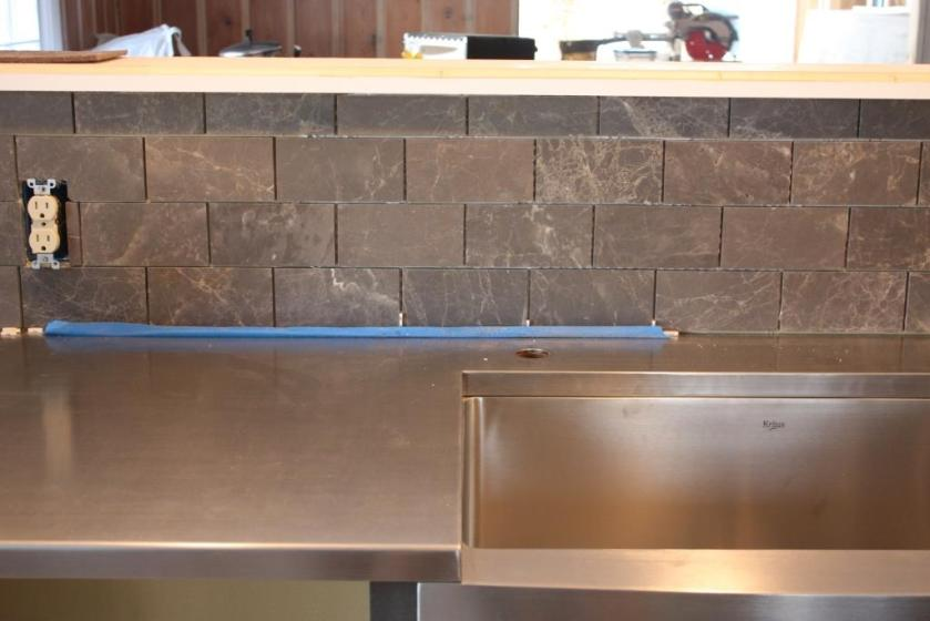 The kitchen backsplash tile -- Sealed Royal Grey Honed Limestone.