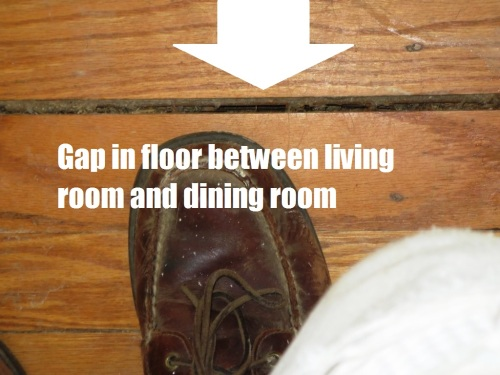 A large gap (almost half an inch) runs between the living room and dining room floor.