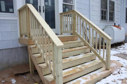 The back steps need time to cure before they can be painted.