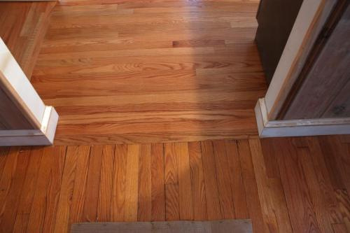 Old dining room floor on the bottom (vertical), new kitchen floor on the top (horizontal). No stain--just poly.