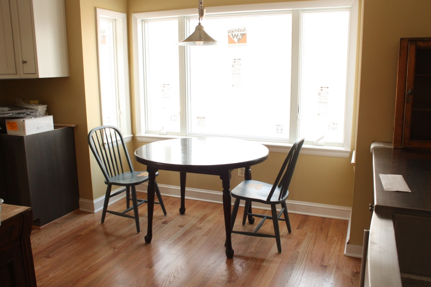A rectangular table would work better in the kitchen.