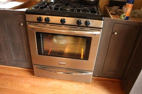 The new stove has 5 burners and a large oven.