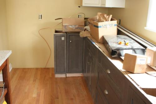 The small end cabinet was permanently installed before the countertop was put in place.