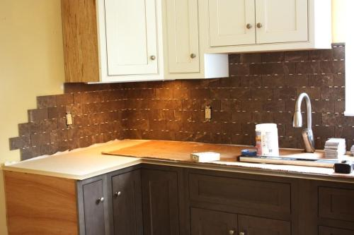 Unfortunately the backsplash cannot be totally finished until the missing upper cabinet is delivered.