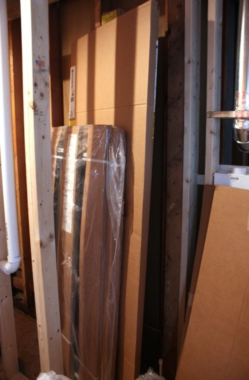 Inside these tall boxes are screens for the French doors.