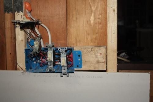 I just notched the top of the drywall so it would snug up against the switch box.