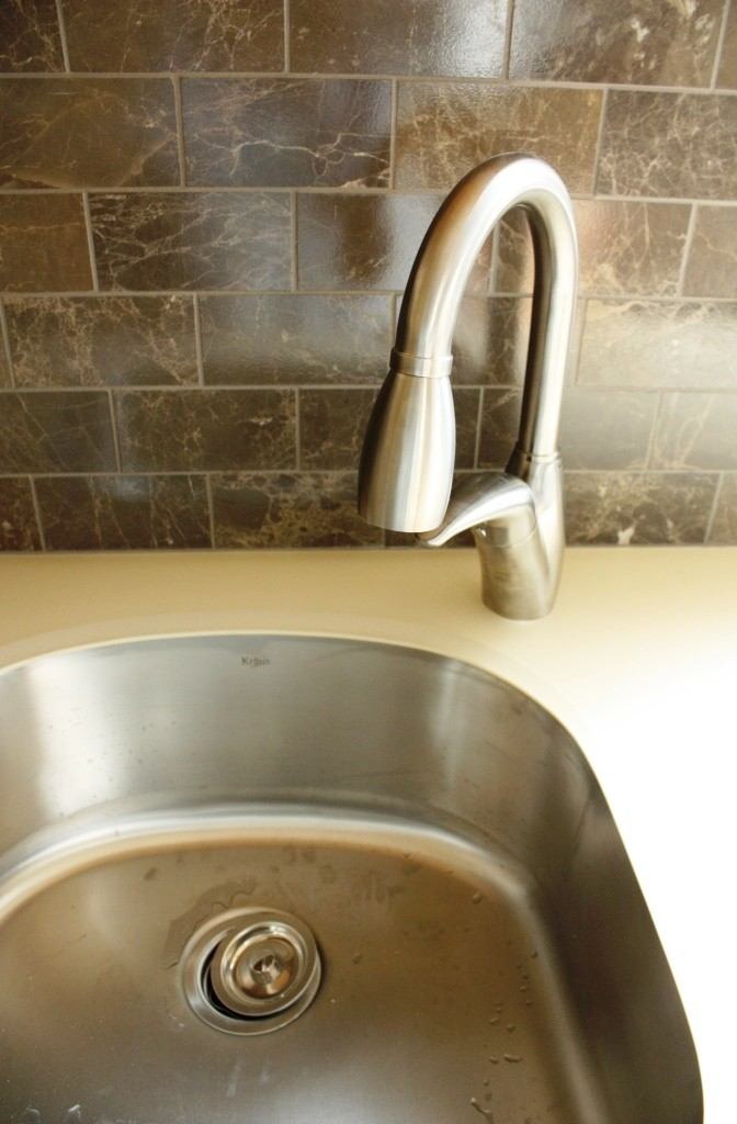 The prep sink has a similar but smaller faucet.