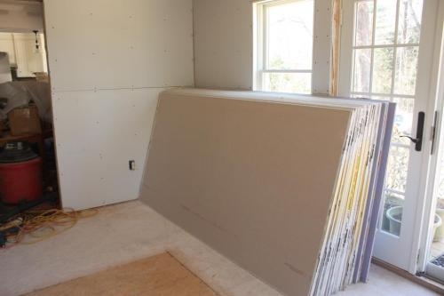 We finally cleared the sheets of drywall off the floor (by leaning them against the wall).