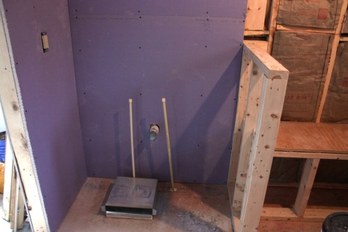 The conservatory bathroom is drywalled except for the cement backer board in the shower.