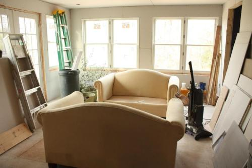 I lugged both of these loveseats from the living room into the conservatory.