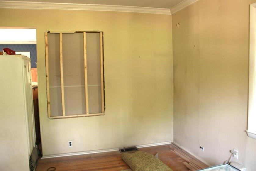 The living room window that was removed needs to be infilled with drywall.