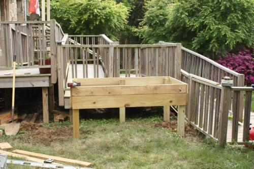 A raised bed for a seated user.