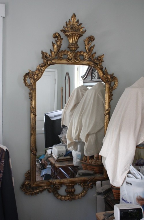 I have this French gilt mirror hanging on the wall for safekeeping until I decide where it should go.
