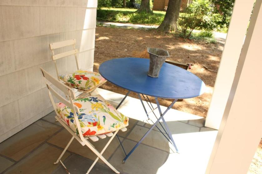 The blue metal table is useful on the porch or in the yard.