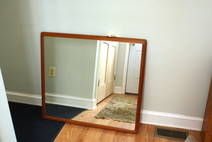 This mid-century modern mirror is very plain and weighs a ton.
