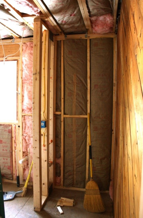 The niche at the end of the hall in the maser suite has been drywalled and is slated to be a linen closet.