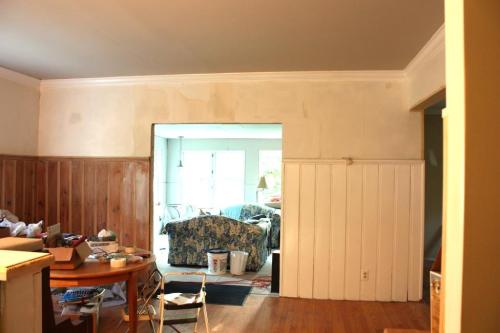 The paneling in the dining room is partially painted.