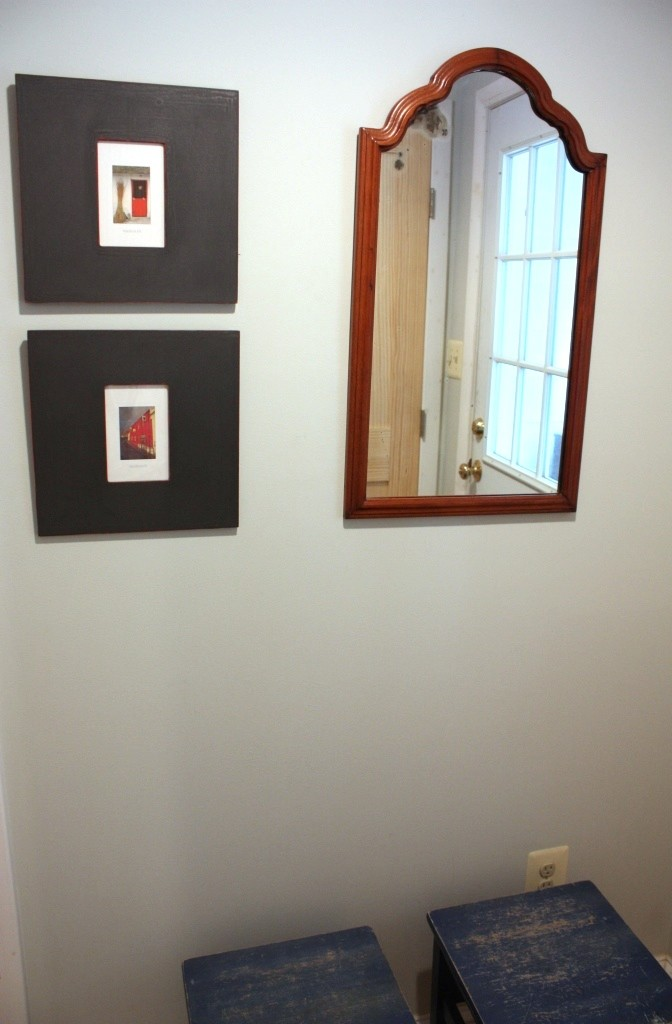 I hung this antique mirror so the bottom edge was at the same level as the bottom of the pictures.