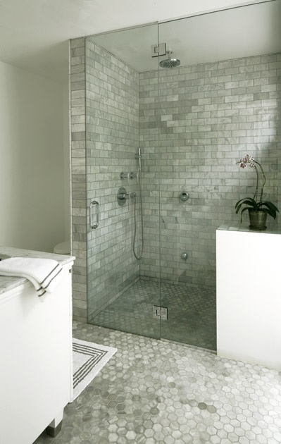 After the tile and plumbing -- shower glass. (This is an inspiration for our shower.)