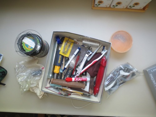 This box of handy but diverse items was sorted and reassigned to the tool area.