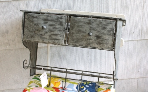 Grey painted metal shelf with hooks from Home Goods.