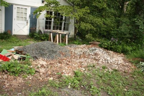 Now the rubble pile is much smaller than the gravel we're saving to spread on the driveway.