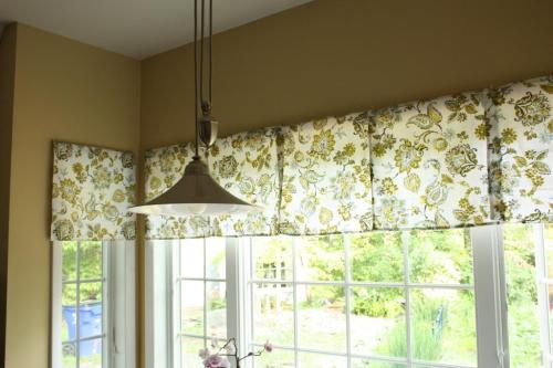 Napkins push-pinned to the window trim