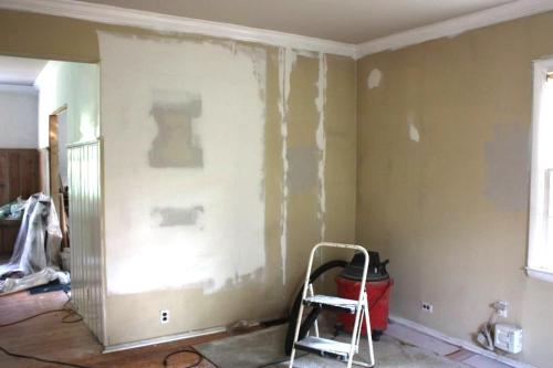 The large area of drywall mud is where a window was removed.