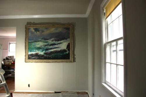 This very large painting won't seem so high off the ground when the furniture is moved back into the room.