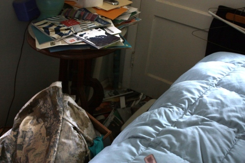 I couldn't even walk around the end of the bed because of the clutter.