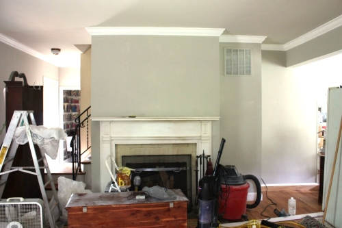 The fireplace wall still needs another coat of paint.