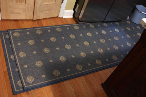 This blue Ballard Designs runner is bordered and banded on 4 sides.
