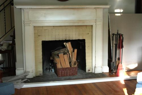 "The exposed brick which had been painted to match the old wall color is sometimes called the ""sideslip"" of a fireplace."